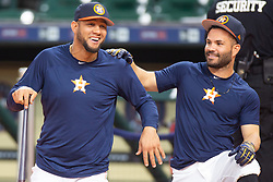 April 13, 2018 - Houston, TX, U.S. - HOUSTON, TX - APRIL 13: Houston Astros first baseman Yuli Gurriel (10) and Houston Astros second baseman Jose Altuve (27) share a laugh on the field prior to a MLB game between the Houston Astros and the Texas Rangers on April 13, 2018 at Minute Maid Park in Houston, TX. (Photo by Juan DeLeon/Icon Sportswire) (Credit Image: © Juan Deleon/Icon SMI via ZUMA Press)
