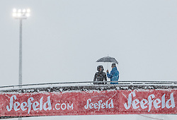 31.01.2016, Casino Arena, Seefeld, AUT, FIS Weltcup Nordische Kombination, Seefeld Triple, Langlauf, im Bild Zuschauer mit dem Seefeld Logo // Spectors stand on a Bridge with a Umbrella during 15km Cross Country Gundersen Race of the FIS Nordic Combined World Cup Seefeld Triple at the Casino Arena in Seefeld, Austria on 2016/01/31. EXPA Pictures © 2016, PhotoCredit: EXPA/ JFK