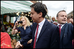 Ed Miliband being egged..Ed Miliband East Street Market Visit. Labour leader Ed Miliband being egged by a member of public during a  living standards related visit to South East London's East Street Market.  This is Milliband's first official visit since coming back from holiday, <br /> East Street Market, London, United Kingdom. Wednesday, 14th August 2013. Picture by Andrew Parsons / i-Images<br /> File Photo - Ukip leader struck by egg as he arrived in Nottingham on national tour today, Thursday, 1st May 2014.