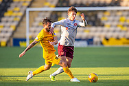 Keaghan Jacobs (#7) of Livingston FC tackles Aaron Hickey (#51) of Heart of Midlothian FC during the Ladbrokes Scottish Premiership match between Livingston FC and Heart of Midlothian at the Tony Macaroni Arena, Livingston, Scotland on 26 October 2019.