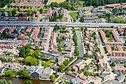 Nederland, Zuid-Holland, Rotterdam, 10-06-2015; stadsdeel Overschie, met Delftse Schie en de RK waterstaatkerk Petrus' Bandenkerk. A13 met geluidsscherm in de achtergrond.<br /> Overschie with river Schie, northern Rotterdam.<br /> <br /> luchtfoto (toeslag op standard tarieven);<br /> aerial photo (additional fee required);<br /> copyright foto/photo Siebe Swart