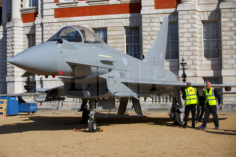 © Licensed to London News Pictures. 31/03/2016. London, UK. Full-size replica of a Eurofighter Typhoon, a First World War Sopwith Snipe and a Second World War Spitfire Mk XVI are being assembled at Horse Guards Parade in London as part of a RAF Museum display organised to mark the centenary of the RAF in 2018. Photo credit: Tolga Akmen/LNP