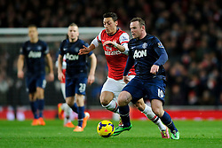Man Utd Forward Wayne Rooney (ENG) and Arsenal Midfielder Mesut Ozil (GER) compete for the ball - Photo mandatory by-line: Rogan Thomson/JMP - 07966 386802 - 12/02/14 - SPORT - FOOTBALL - Emirates Stadium, London - Arsenal v Manchester United - Barclays Premier League.