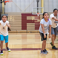 Cuylee Frank, 8, left, and Kyleigh Toadlena, 9, pass the ball during an offensive drill at Rehoboth Christian School's True Hoops Basketball Camp, Tuesday, July 16 in Rehoboth.