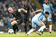 Celtic's Scott Brown (8) and Manchester City's Ilkay Gundogan (8) during the Champions League match between Manchester City and Celtic at the Etihad Stadium, Manchester, England on 6 December 2016. Photo by Craig Galloway.