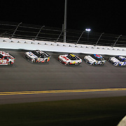 NASCAR Sprint Cup driver Kevin Harvick (29) leads in turn four of the NASCAR Sprint Unlimited Race at Daytona International Speedway on Saturday, February 16, 2013 in Daytona Beach, Florida.  (AP Photo/Alex Menendez)