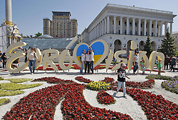 May 6, 2017 - Kiev, Ukraine - Ukrainians walk in front of a decorative the Eurovision Song Contest 2017 logo, on Independence Square in Kiev, Ukraine, on 06 May 2017. The goal of the motocross is to demonstrate to the participants of the Eurovision-2017 and the guests of the capital that diversity and freedom are the highest values for the Ukrainian people. The will contest consist of two semi-finals that will be held on 9 and 11 May and a grand final that will take place at the International Exhibition Centre in Kiev on 13 May. (Credit Image: © Serg Glovny via ZUMA Wire)