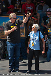 Chris McGee on stage with 90-year old rider Gloria Struck (rode HD Softail from NJ to SD!) before the start of the Legends Ride from Deadwood during the 75th Annual Sturgis Black Hills Motorcycle Rally.  SD, USA.  August 3, 2015.  Photography ©2015 Michael Lichter.