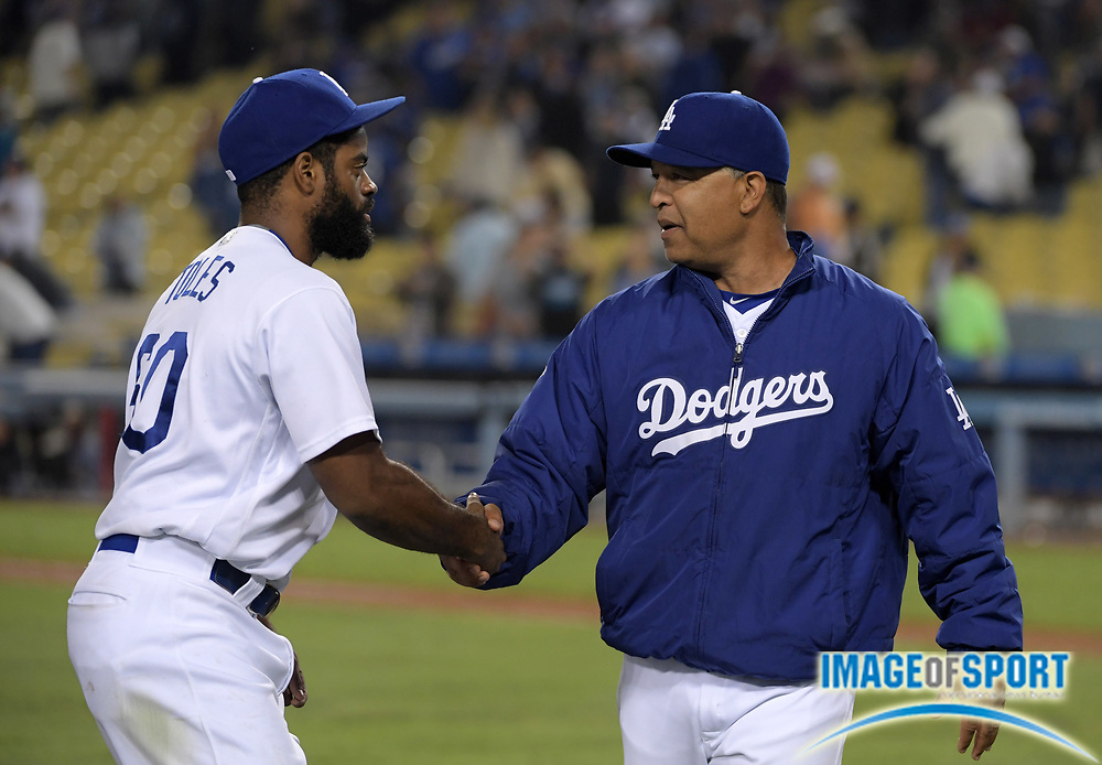Sep 6, 2016; Los Angeles, CA, USA; Los Angeles Dodgers manager Dave Roberts (30) shakes hands wtih Los Angeles Dodgers right fielder Andrew Toles (60) after a MLB game against the Arizona Diamondbacks at Dodger Stadium.