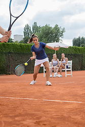Women playing tennis on a sunny day, Bavaria, Germany