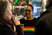 Ali Muldrow, center, talks with attendees at the Madison School Board election watch party at Robinia Courtyard in Madison, Wisconsin, Tuesday, Feb. 19, 2019.