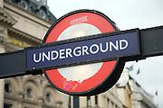 Underground rail roundel sign, London, England