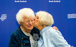 Pictured: Journalist Ructh Wishart and Liz Lochhead,  a Scottish poet, playwright, translator and broadcaster. Between 2011 and 2016 she was the Makar, or National Poet of Scotland<br /> Book fanatics headed to Charlotte Square in Edinburgh which is the hub of the international Book Festival to meet the authors and also to meet up with fellow fans of the printed word.<br /> <br /> <br /> Ger Harley | EEm 22 August 2017