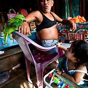 Raúl Hernández playing with his niece, Noemí, at breakfast time. Tuzantán, Mexico.