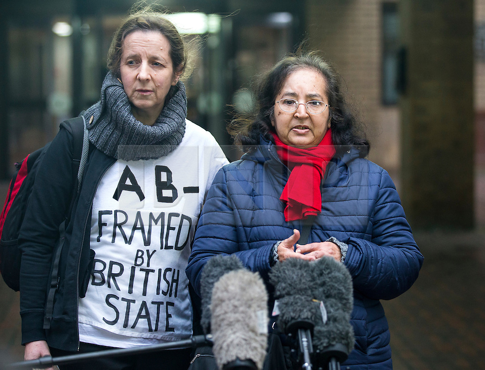 """© Licensed to London News Pictures. 29/01/2016. London, UK. JOSEPHINE HERIVEL (L) wearing a t-shirt with the words """"A B - FRAMED BY BRITISH STATE""""  written on it, stands next to CHANDRA BALAKRISHNA (R), the wife of Aravindan Balakrishnan, as she speaks to media as they leave Southwark Crown Court in London where Maoist cult leader Aravindan Balakrishnan has been sentenced to 23 years in prison for rape, child cruelty and false imprisonment. Aravindan Balakrishnan was found guilty of the rape of two of his followers and and false imprisonment of  his daughter for more than 30 years in a commune in south London.  Photo credit: Peter Macdiarmid/LNP"""