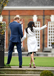 Prince Harry and Meghan Markle at a photocall to announce their engagement at Kensington Palace, London. Photo credit should read: Doug Peters/EMPICS Entertainment