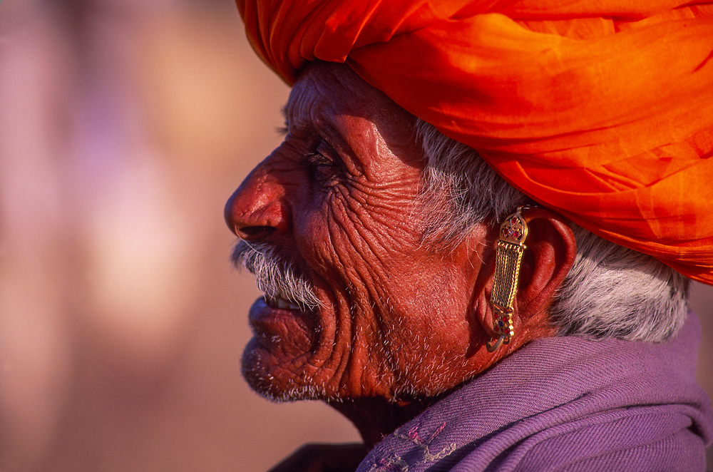 Rajasthani man wearing orange turban, Pushkar Camel Fair, Pushkar, Rajasthan, India