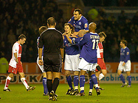 Fotball<br /> Foto: SBI/Digitalsport<br /> NORWAY ONLY<br /> <br /> Leicester City v Coventry City<br /> Coca Cola Championship. 08/11/2004.<br /> <br /> Leicester City's Lilian Nalis (C) is mobbed by teammates after putting his side 1-0 up.