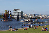 Cardiff , UK , bank holiday Monday 28th August 2017.  people enjoy the bank holiday sunshine in Cardiff as the Extreme Sailing series 2017 goes on at Cardiff Bay. pic by Andrew Orchard