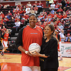 Feb 24, 2009; Piscataway, NJ, USA; Rutgers center Kia Vaughn (left) is celebrated prior to Rutgers' 71-53 victory over Cincinnati at the Louis Brown Athletic Center for being the fourth player in Rutgers' history to score 1,000 points and get 1,000 rebounds.