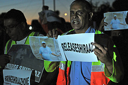 LENASIA, SOUTH AFRICA - JANUARY 18: Member of the public march to a community hall hosting a night vigil for kidnapped photojournalist Shiraaz Mohamed, on January 18, 2014 in Johannesburg, South Africa. Community members, friends, family and colleagues of photojournalist Shiraaz Mohamed held a night vigil at the Lenasia South Civic Centre. Mohamed was abducted in Syria on 10 January while working with the aid mission Gift of the Givers. (Photo by Dino Lloyd)