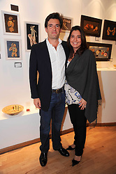 Leading fund manager GUY DE BLONAY and his wife ANNA at a private view of artist Georgina Barclay's work entitled 'Loves & Curiosities' held at the Air Gallery, Dover Street, London on 17th November 2009