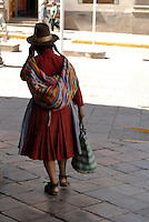 A quechua woman with a shopping bag in Cusco, Peru
