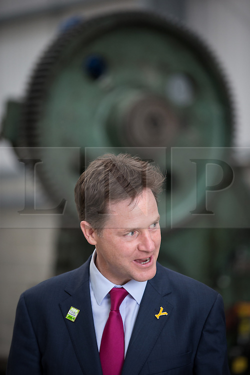 © Licensed to London News Pictures . 04/07/2014 . Sheffield , UK . The Deputy Prime Minister , NICK CLEGG MP , in front of a big cog at Chapmans Agricultural Parts on Friday 4th July 2014 as this morning (Monday 7th June 2014) Nick Clegg launches the British Government's local Growth Deals . The Government says that £12 billion will be invested in local business , training and infrastructure projects .  Photo credit : Joel Goodman/LNP .  Photo credit : Joel Goodman/LNP