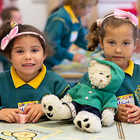 Twins Melissa and Melanie Rose Withers-Cantillo sit together during their first day of school at Gaelscoil Mhíchíl Cíosóg, Inis