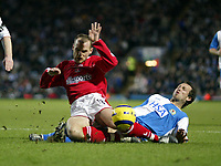 The FA Barclays Premiership<br />3 January 2005, Ewood Park, Blackburn<br />Blackburn Rovers v Charlton Athletic<br />Blackburn Rovers Lucas Neill makes a superb tackle as Charlton Athletic's Danny Murphy bursts into the penalty box<br />Pic Jason Cairnduff/Back Page Images