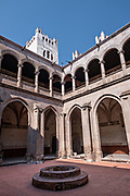 View of the central convent courtyard at the San Nicolas Tolentino Temple and Ex-Monastery in Actopan, Hidalgo, Mexico. The colonial church and convent  was built in 1546 and combine architectural elements from the romantic, gothic and renaissance periods.