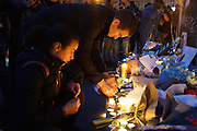 Place Republique, Parisians pay hommage to those killed and wounded in the Terrorist attacks<br /><br />The Day after the terrorist jihadi attacks. Bullet holes and blood, mourning homage and cleaning up. Aftermath of deadly Paris terrorist attacks. Saturday 14th November 2015<br /> <br /> Eight terrorists dead and some 128 people killed at Stade de France, Bataclan concert Hall, Belle Equipe Restaiurant, Rue Fontaine au Roi, Two hundred people have been injured, 80 of them seriously.