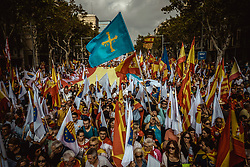 October 12, 2017 - Barcelona, Catalonia, Spain - Anti-separatist Catalans shout slogans as they march through the city of Barcelona as they protest for the indivisibility Spain's two days after a suspended independence declared by the pro-separatist Catalan Government (Credit Image: © Matthias Oesterle via ZUMA Wire)