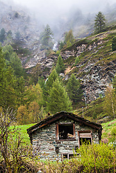 Derelict stone mountain  home Zermatt Switzerland. I don't think I could leave a setting as perfect as the place at the foot fo an alpine peak with a waterfall above.