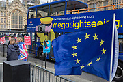 As Prime Minister Theresa May again meets opposition Labour leader Jreemy Corbyn in an attempt to break the deadlock in parliament of Brexit, a Megasightseeing tour bus passes protestors opposite parliament in Westminster, on 4th April 2019, in London, England.