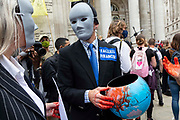 Two faceless financier climate activists from Extinction Rebellion talk to each other just outside the Bank of England on 27th August, 2021 in London, United Kingdom. The activist group Extinction Rebellion XR are planning actions of disruption for two weeks straight beginning on August 23rd, 2021 in an effort to bring awareness and priority to the global climate emergency in advance of the COP 26 Summit which will be held in Glasgow later this year.