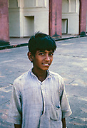 Head and shoulders portrait of young boy wearing dirty shirt in Uttar Pradesh, India 1964