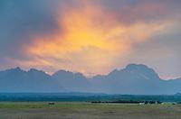 Sunset through storm clouds over the Teton Range,  Grand Teton National Park, Wyoming