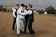 Police manage to intercept some of the climate activists but let them all go after confiscating various suspecious items.  <br /> <br /> Crude Oil Awakening is a coalition of climate change activist groups. On Saturday Oct 16 they shut the only entrance to Coryton oil refinery in Essex, UK with the aim of highlighting the issues of climate change and the burning of fossil fuels. The blockade meant that a great number of trucks with oil were not able to leave the refinary during the day of action.