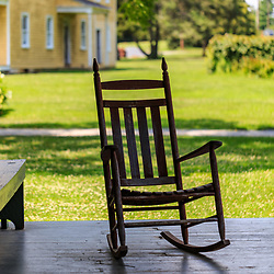 Lancaster, PA – July 13, 2016:  A rocking chair on a porch on the grounds of the Landis Valley Village & Farm Museum.