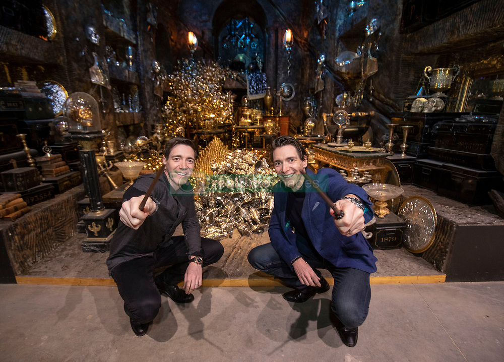 James Phelps (left) and Oliver Phelps in front of the Lestrange Vault set at the opening of the new Gringotts Wizarding Bank expansion at the Making Of Harry Potter attraction at the Warner Bros Studio Tour, in Watford.