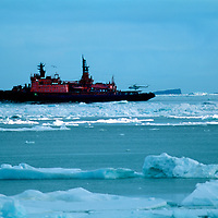 """FRANZ JOSEF LAND, RUSSIA. Helicopter takes off from Russian nuclear icebreaker """"Yamal"""" near Cape Tegethoff in this polar archipeligo in Arctic Ocean."""