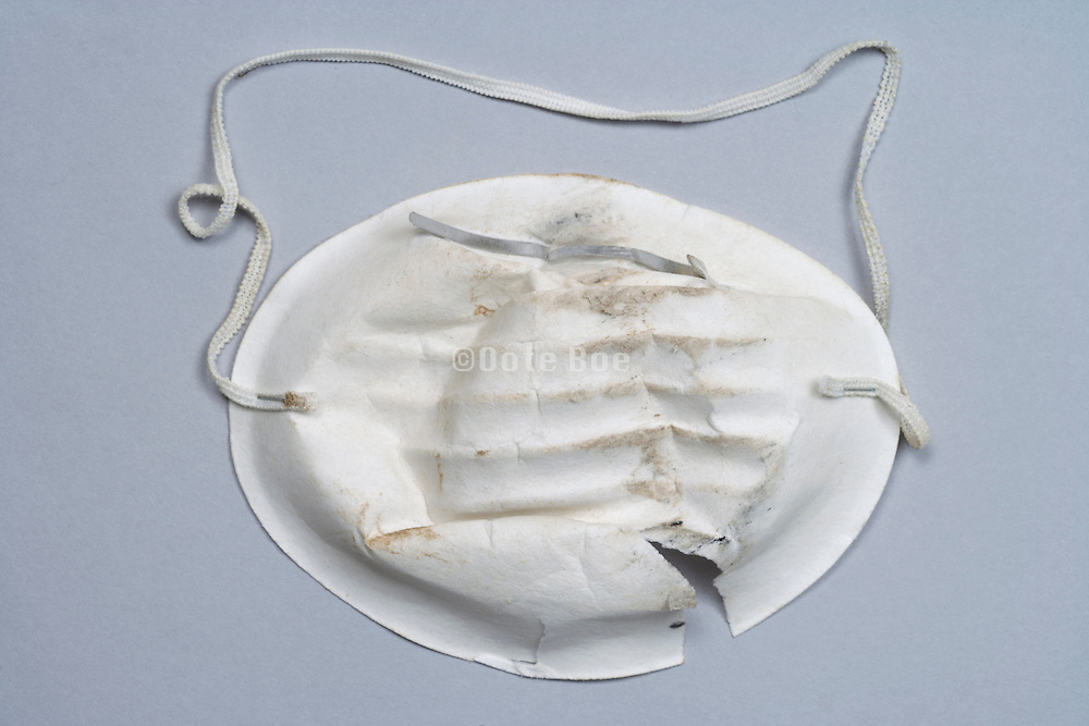 used and broken paper dusk mask