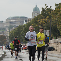 People participate the Budapest Marathon across the streets in downtown Budapest, Hungary on Oct. 10, 2021. ATTILA VOLGYI