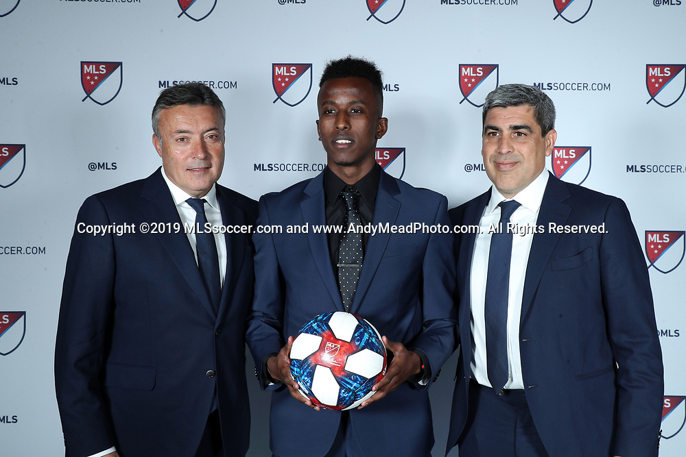 CHICAGO, IL - JANUARY 11: Abdi Mohamed was taken with the 43rd overall pick by New York City FC. With head coach Domenec Torrent (left) and sporting director Claudio Reyna (right). The MLS SuperDraft 2019 presented by adidas was held on January 11, 2019 at McCormick Place in Chicago, IL.
