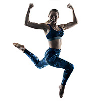 one caucasian woman exercising fitness excercises jumping in silhouette isolated on white background