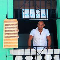 Central America, Cuba, Trinidad. Cuban drink vendor in Trinidad.