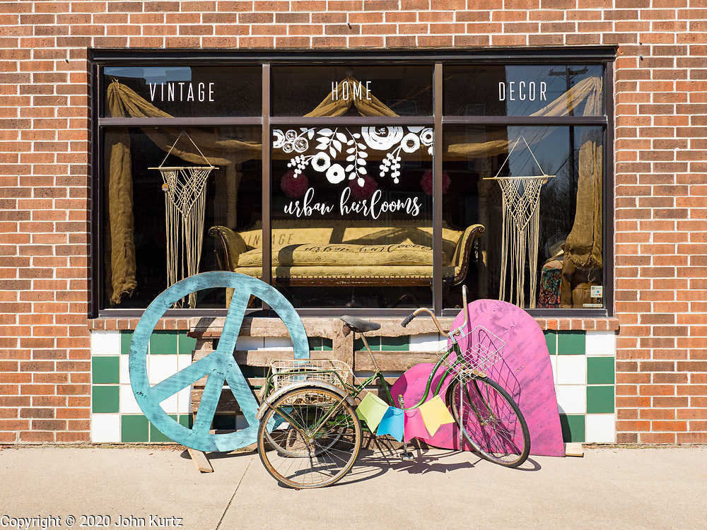 """26 APRIL 2020 - JEWELL, IOWA: A business in Jewell closed because of the COVID-19 pandemic. Jewell, a small community in central Iowa, became a food desert when the only grocery store in town closed in 2019. It served four communities within a 20 mile radius of Jewell. Some of the town's residents are trying to reopen the store, they are selling shares to form a co-op, and they hold regular fund raisers. Sunday, they served 550 """"grab and go"""" pork roast dinners. They charged a free will donation for the dinners. Despite the state wide restriction on large gatherings because of the COVID-19 pandemic, the event drew hundreds of people, who stayed in their cars while volunteers wearing masks collected money and brought food out to them. Organizers say they've raised about $180,000 of their $225,000 goal and they hope to open the new grocery store before summer.            PHOTO BY JACK KURTZ"""