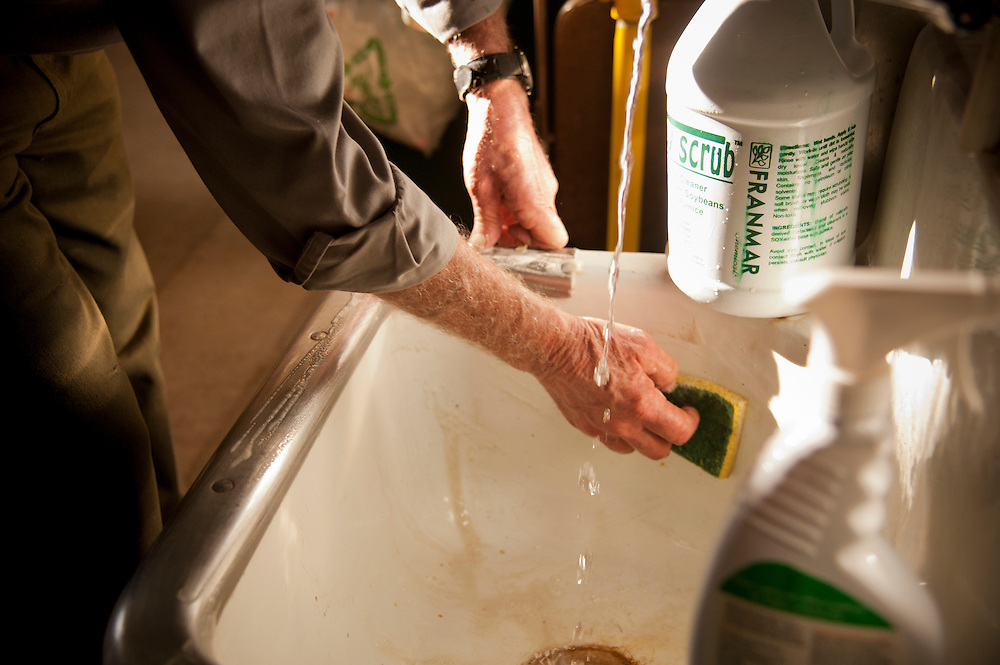 Pictured Rocks National Lakeshore employee William Magli cleans a utility sink with a soy-based cleanser.