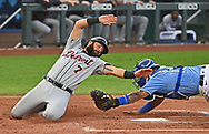 Detroit Tigers catcher Austin Romine (7) attempts to slide around the tag by Kansas City Royals catcher Salvador Perez (13) at home plate during the first inning at Kauffman Stadium.